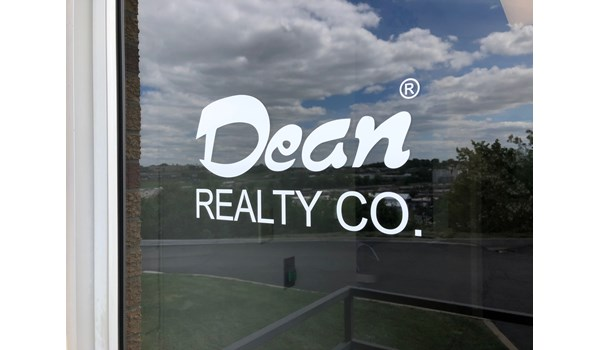 White Cut Vinyl door decal for Dean Realty Company in Kansas City, Missouri