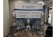 Curved Fabric Backdrop and Literature Racks for Midwest Builders Casualty in Kansas City, Missouri