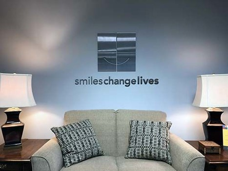 Interior Stainless Steel Dimensional Logo for Smiles Change Lives in Kansas City, Missouri