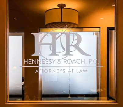 Interior Frosted Etched Vinyl Logo for Window Glass at Hennessy & Roach, P.C. in Overland Park, Kansas