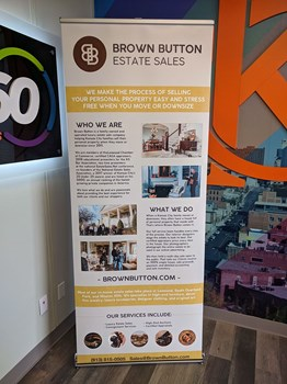 Retractable Banner Stand for Brown Button Estate Sales in Kansas City, Missouri